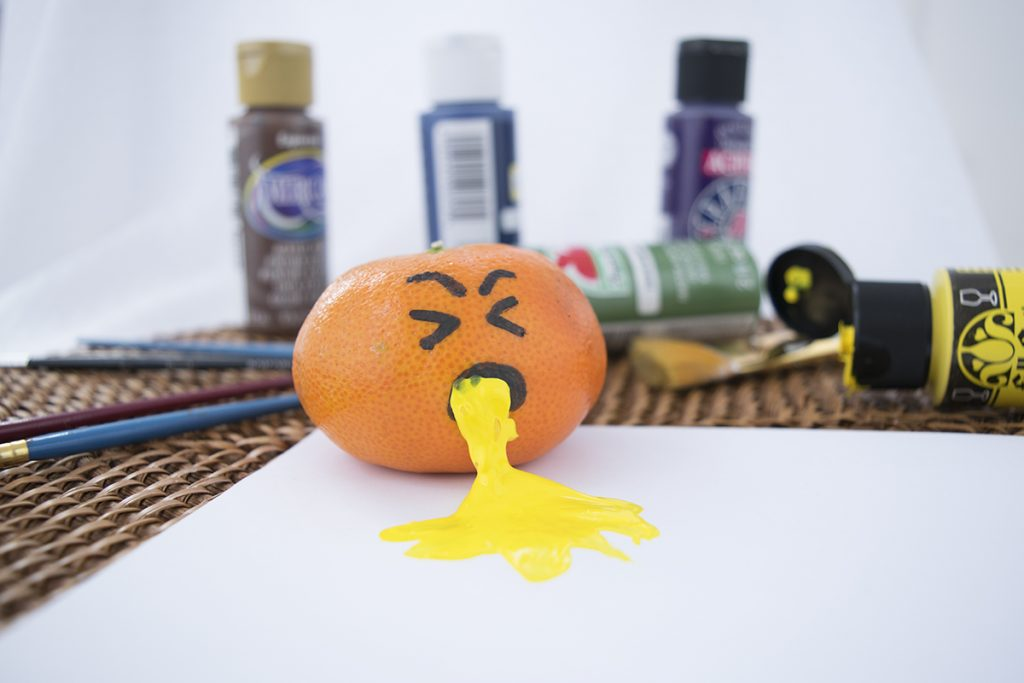 An orange vomiting paint