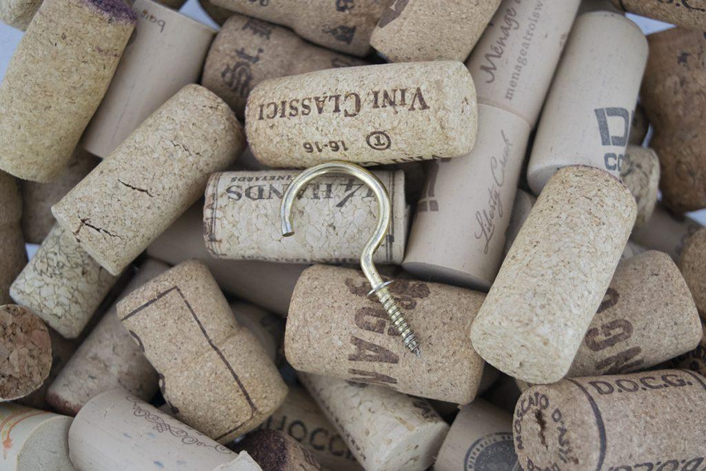 A brass hook on wine corks