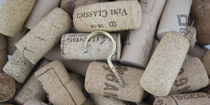 A brass hook on wine corks
