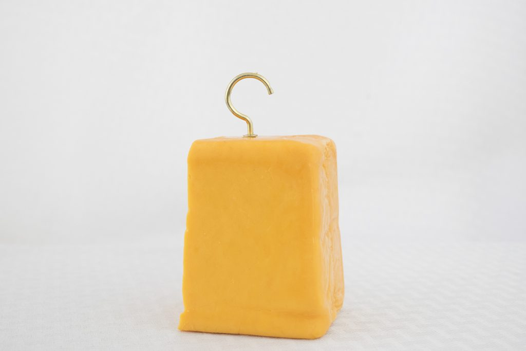 A brass hook in a block of chedder