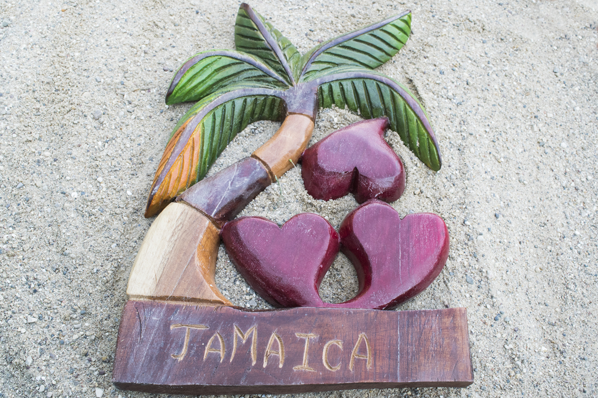 A tacky wood carving in sand